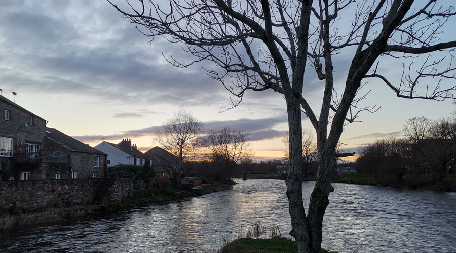 The meeting of the river Cocker to the Derwent in Cockermouth at dusk